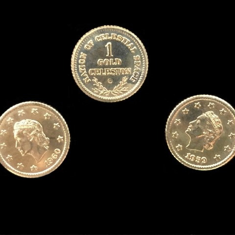 "Three gold coins on a black surface. The are bright and shiny. Two are heads up showing a woman wearing a crown with stars ringing the border of the coin and ""1959."" One is the same with ""1960"" as the year listed. The third coin is tails-up and says ""Nation of Celestial Space 1 Gold Celestron"" with some laurel leaves"