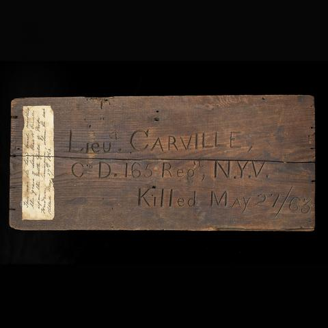 Carved wooden temporary grave marker of Lieutenant Charles R. Carville