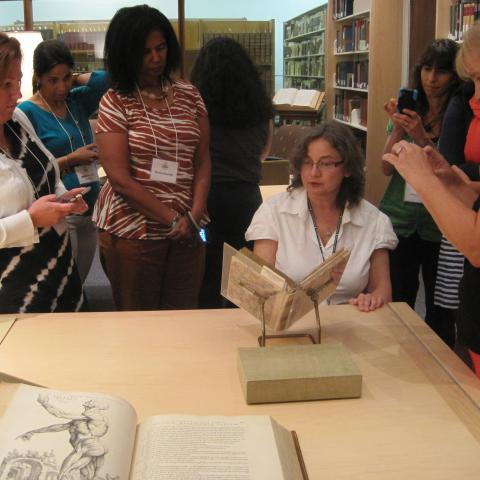 Teachers look at historic books