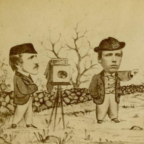 Detail of image: two men with camera and hats