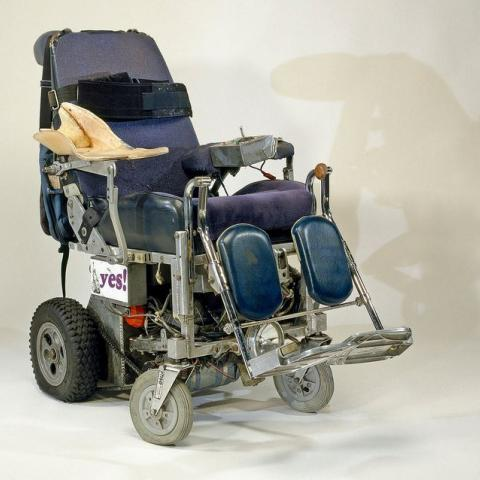 "Power wheel chair with ""yes!"" bumper sticker on side"