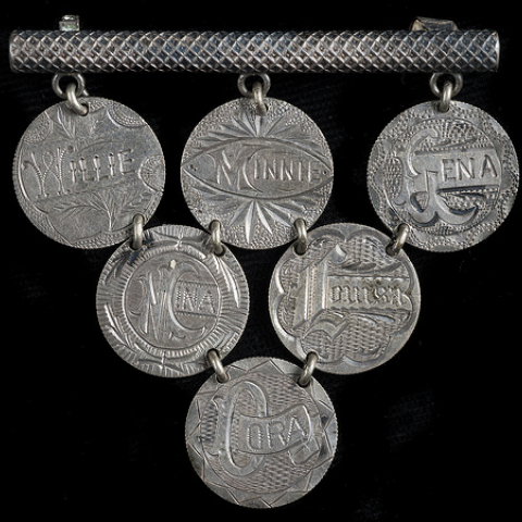 A brooch made of dimes