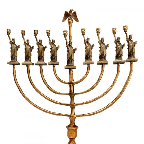 Gold-colored Hanukkah lamp decorated with Statue of Liberty figures and an eagle