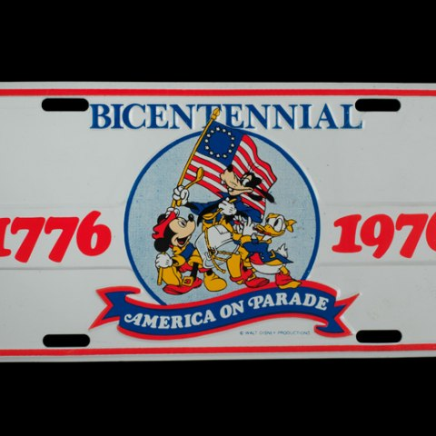 License plate showing Disney characters and bicentennial years, 1776 and 1976