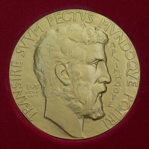 Medal with man's face in profile