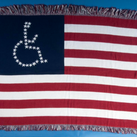 Woven American flag with person in wheelchair symbol instead of stars