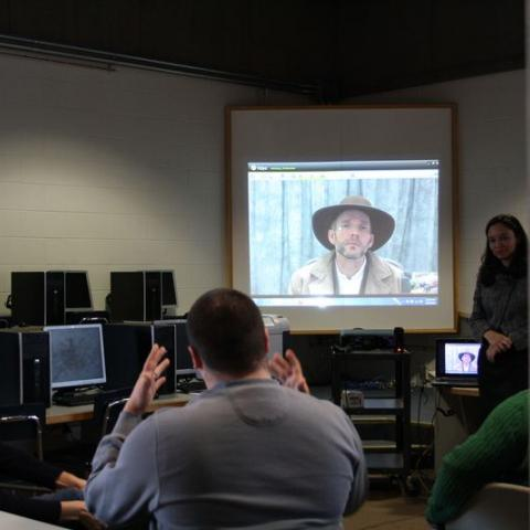 Teachers watch video in classroom