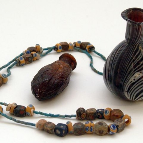 Glass bottles (two) and glass beads on string