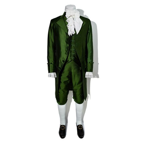 A green three piece suit, white tights, and black buckle shoes.