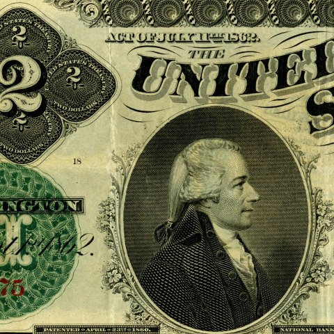 Detail of a bill featuring a portrait of Hamilton in profile