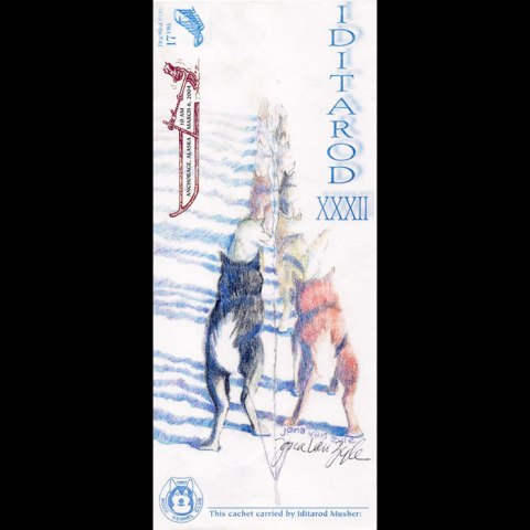 Mail cache decorated with illustration showing a sled dog team from the perspective of a musher