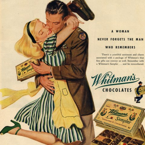 """This October 9, 1944, advertisement for Whitman's chocolate boxes shows a woman embracing a soldier in uniform kissing her cheek. On the bottom right is a box of Whitman's Chocolate Sampler. The bold font reads, """"A WOMAN NEVER FORGETS THE MAN WHO REMEMBERS,"""" and, """"BUY MORE WAR BONDS."""" In fine print below the box of chocolates reads, """"If you can't always get your favorite Sampler, remember it's because millions of pounds of Whitman's Chocolates are going to all our fighting fronts."""""""
