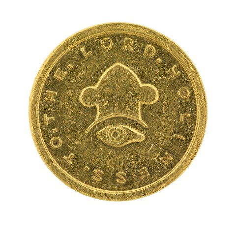 Gold coin with eye in center