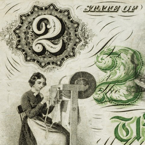 Close up image of part of a bill. Image of woman weaving.