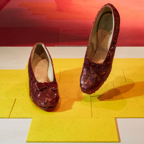 Photo of the Ruby Slippers on a yellow background