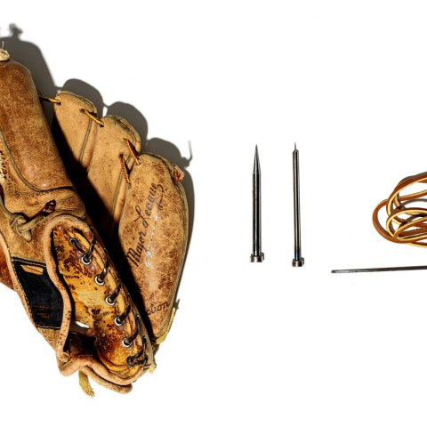 Photograph of Ernie Martinez's re-stitched baseball glove and repair tools.
