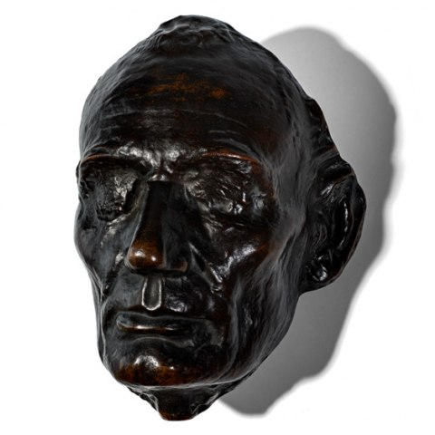 Bronze Abraham Lincoln life mask on white background
