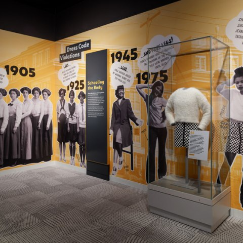 Case showing changes in girls' uniforms in exhibition, Girlhood: It's complicated