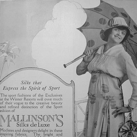 """Black and white ad with photo of woman in dress with polka dots and umbrella with polka dots. Text: """"Silks that express the spirit of sport."""""""