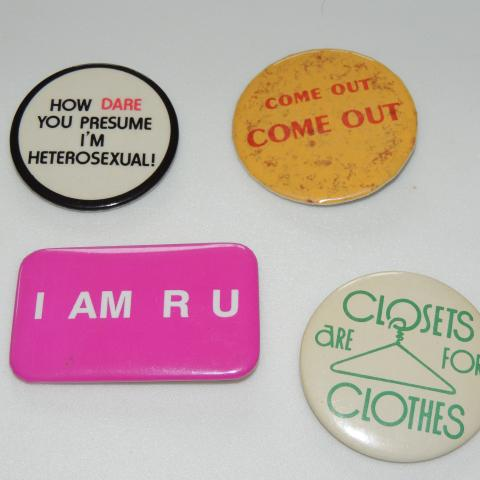 "Four buttons. ""How dare you presume I'm heterosexual!"" ""Come out, come out."" ""I AM R U."" ""Closets are for clothes."""