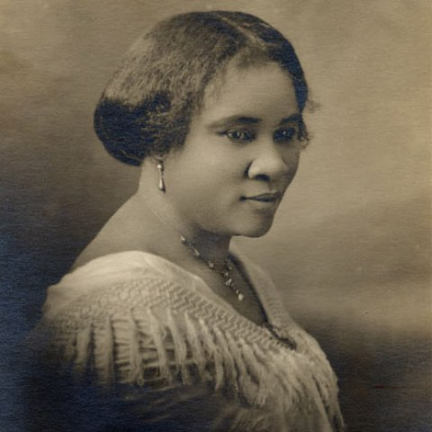 A sepia tone portrait of Madam CJ Walker