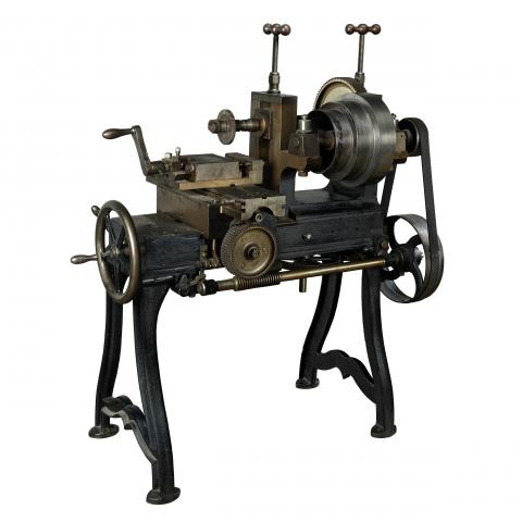 Milling machine with cranks and gears and four feet, table sized