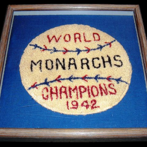 """Jacket patch designed to look like a baseball with text: """"World Monarchs Champions 1942"""""""