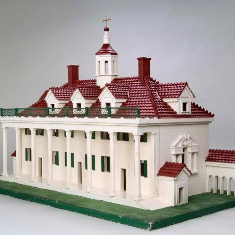 3D model of Mt. Vernon with red roof, white walls, green grass. Many columns and windows.