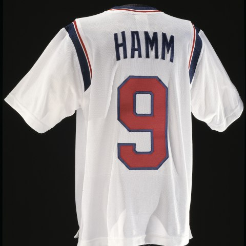 "White jersey with red nine on the back. Text: ""HAMM."""