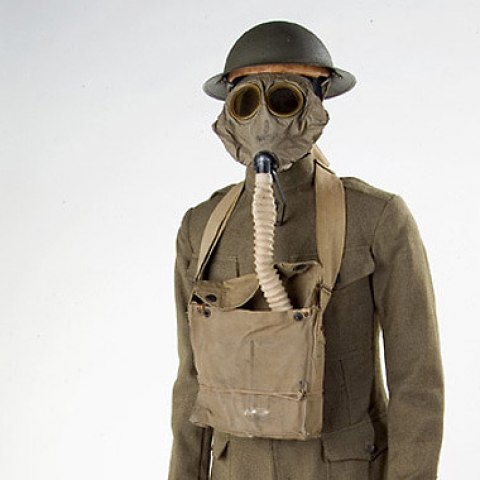Doughboy uniform in khaki and green with helmet and gas mask