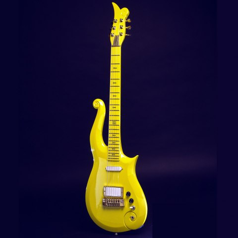 Yellow guitar, dark blue background.