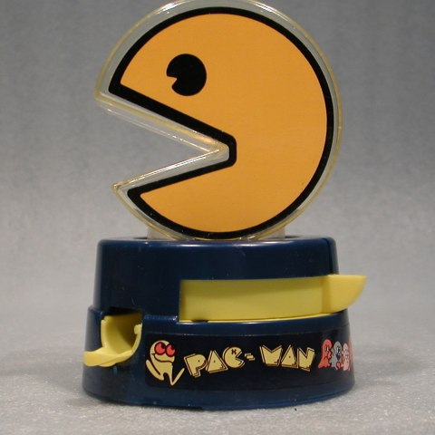 Black base with Pac-Man logo. On top, large yellow Pac-Man.