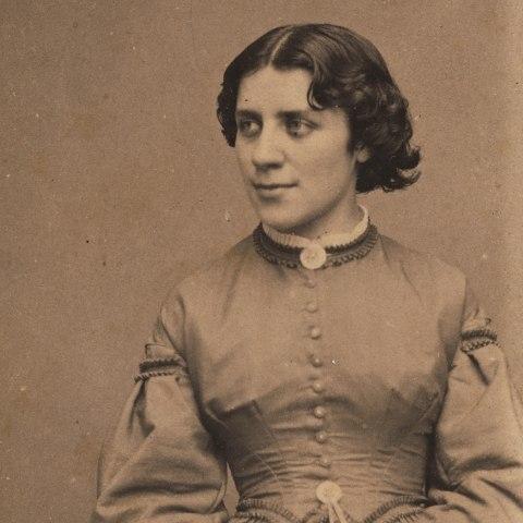 Anna Dickinson, seated