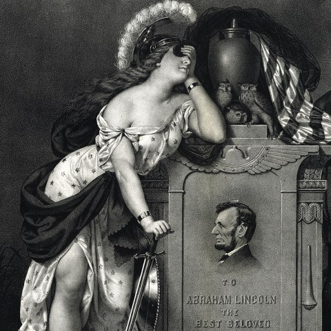 """(Detail) Black and white illustration of Lincoln's headstone. At his feet, a mythical beast lays half dead, near a scroll that says """"Emancipation Act."""" A figure of Liberty(?) covers her eyes, leaning against it. A figure with dark skin holds his hand to his face. Owls and an American flag on top."""