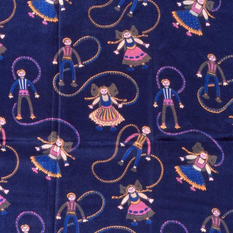 Photo of fabric. Dark blue background. Images of small children wearing pink, brown, white, and blue outfits. Attached together with string.