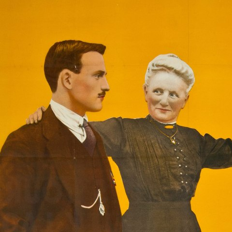 "(Detail) Poster with striking orange background. Color illustration of a young man with hand in pocket and mother with arm raised. Text: ""Go! It's your duty lad. Join to-day."""