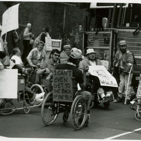 """""""I can't even get to the back of the bus""""; ADAPT activists protesting for accessible transportation, Philadelphia, 1990"""