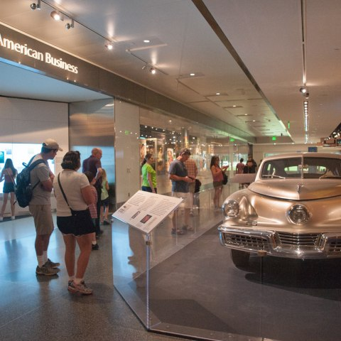 Photograph of the Tucker sedan on display on the museum floor