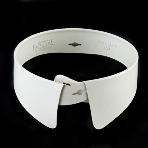 White celluloid collar on black background