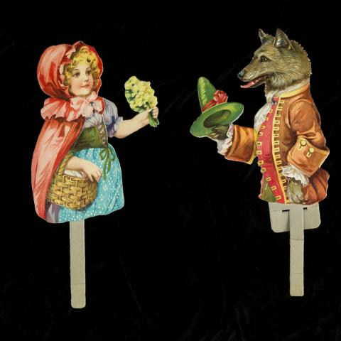 Little girl paper puppet and wolf paper puppet