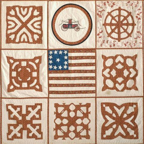 Photo of panels of quilt, one with American flag in center