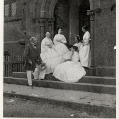 A family under the Smithsonian Castle doorway