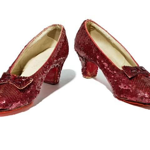 Pair of Ruby Slippers with red sequins and bows, very sparkly but worn