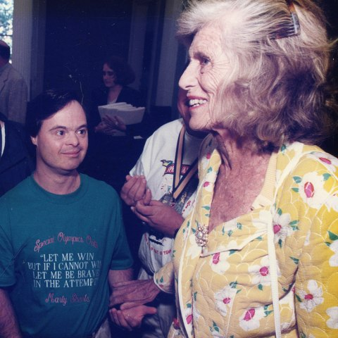 Sheets wearing the Special Olympics oath on his shirt with Eunice Kennedy Shriver. Courtesy of Dave Sheets.