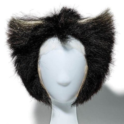 A black wig on a white mannequin head. It is cut flat across the top, and curved on the sides.