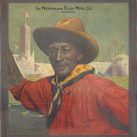 A movie poster for an African American action character. He wears a vivid crimson shirt, a kerchief secured around his neck by a metal ring, a cowboy hat on, and he stands in from of a large white structure in the background that has flags, towers, and domes.