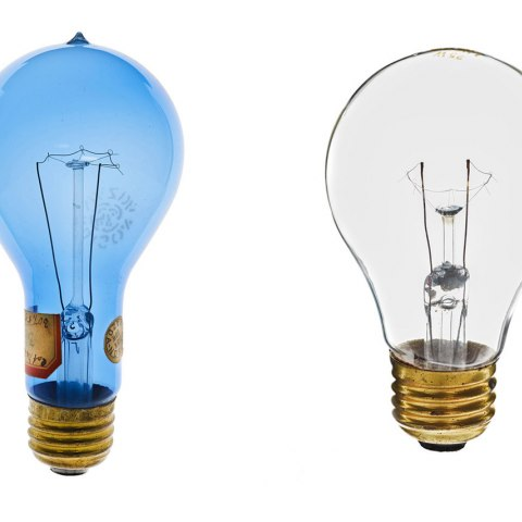 Two lightbulbs, the bulb on the left has a blue cast