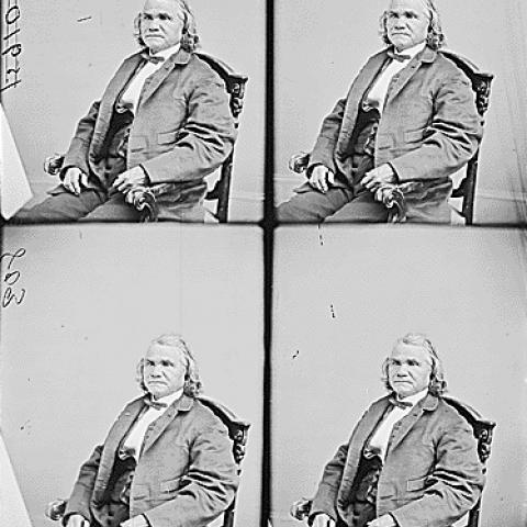 For portraits of man seated in chair, wearing jacket and bowtie