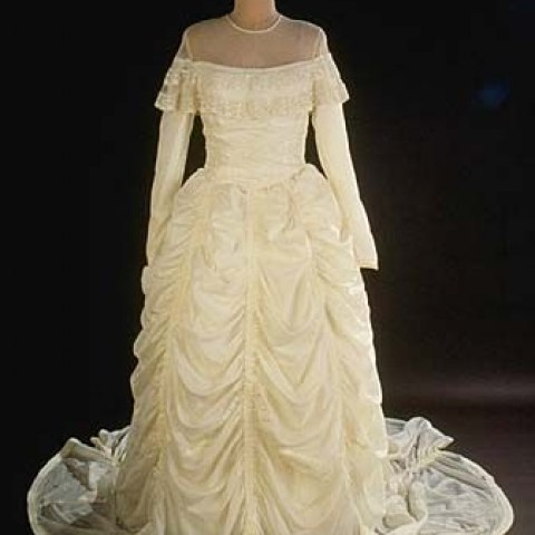Wedding gown with long sleeves and rouching