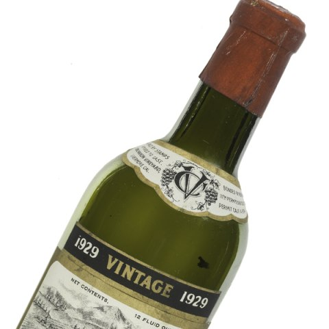 The top of a green wine bottle.